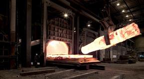 Large ingot has been heated to 1200C prior to forging in press - Heating by REBOX - oxyfuel solutions for reheating.