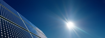 Outdoor image of Crystalline Silicon Solar Cell panel installation in full sunlight.